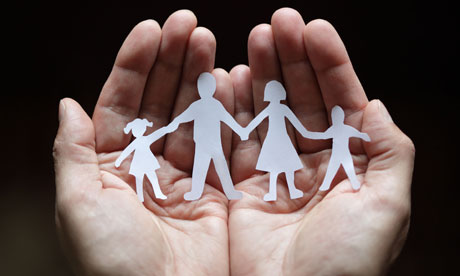 paper-chain family in cupped hands